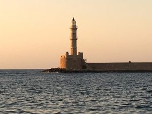 chania lighthouse at sunset in crete greece