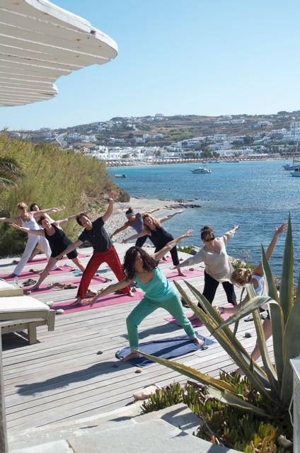 Yoga Escapes class on beach decking