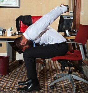 seated forward bend in a chair at your desk