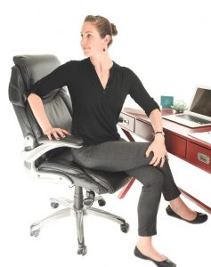 seated spinal twist in a chair at your desk