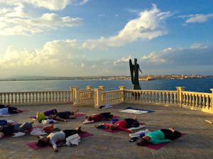 supine twists on a luxury yoga retreat in italy