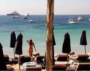 psarou beach in mykonos greece