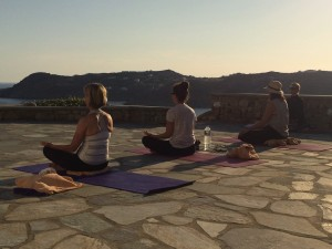 Sunset meditation in Mykonos on yoga retreat