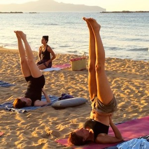 Shoulderstand on the beach at Yoga Escapes