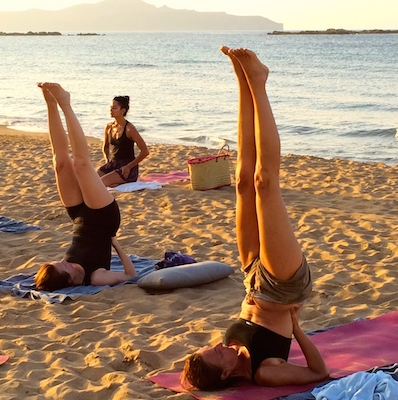 shoulderstand-on-the-beach-with-yoga-escapes