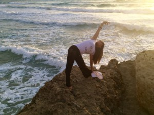 Evening sunset yoga on cliff in Crete