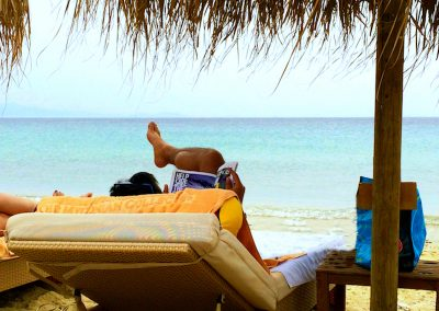 relaxing on the beach on a yoga retreat in mykonos