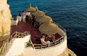 cova d'en xoroi sunset bar for drink in menorca spain