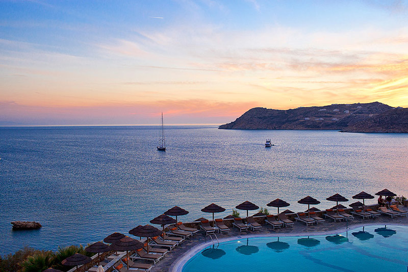 sunset from the luxury myconian imperial hotel on a yoga retreat in mykonos greece