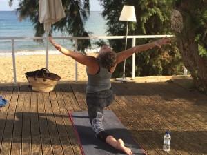 Backbend stretch at the luxury yoga retreat in Crete.