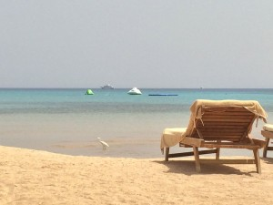 relaxing on the beach on a luxury yoga holiday in egypt