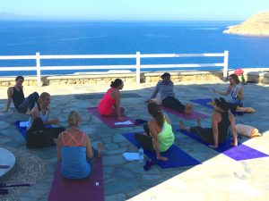 chatting before yoga class in mykonos greece