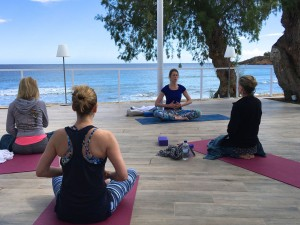Breathing exercise at the yoga retreat in Crete.