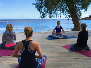 breathing practice on a luxury yoga retreat in crete greece with yoga escapes