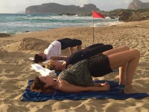 bridge-pose-on-beach-crete