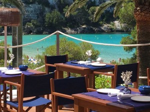 Cape Nao restaurant with a beach view in Menorca, Spain.