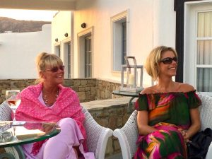 sunset drinks in mykonos greece with Yoga Escapes