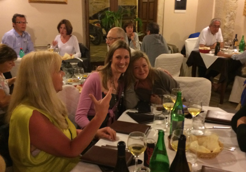 Guests enjoying a meal in the Yoga Retreat of Sicily