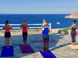 tadasana pose on a yoga retreat in mykonos greece with Yoga Escapes