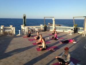 Meditation at the luxury yoga retreat, Italy.