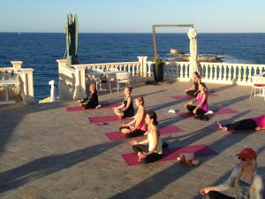 meditation during a luxury yoga retreat in sicily italy