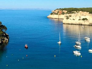 Sail boats on the coast in menorca spain yoga retreat