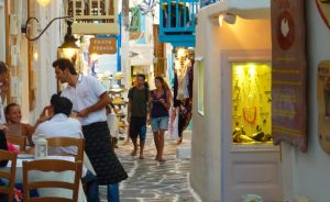 strolling around mykonos town on a yoga retreat with Yoga Escapes