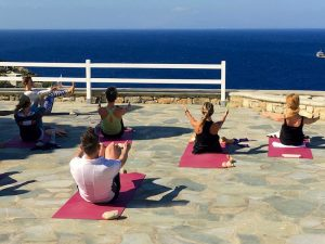 navasana by the sea on a yoga retreat in mykonos greece with Yoga Escapes