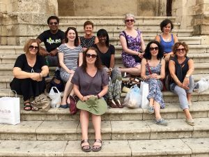 yoga group relaxing in noto sicily on a yoga retreat day trip