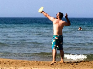 Playing racquet sports on the beach in Crete.