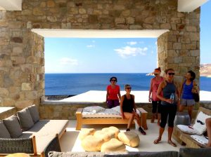 relaxing at a luxury 5 star hotel in mykonos with yoga escapes