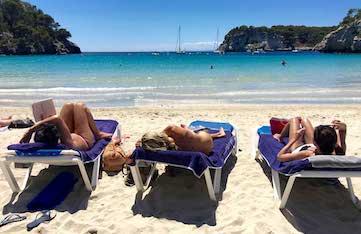 relaxing on cala galdana beach in menorca spain
