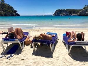 Relaxing on Cala Galdana beach in Menorca.