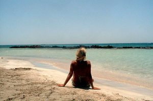 relaxing on elafonissi beach in crete greece with yoga escapes