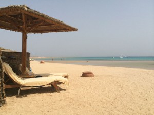 Relaxing on the beach on an Egypt yoga retreat.