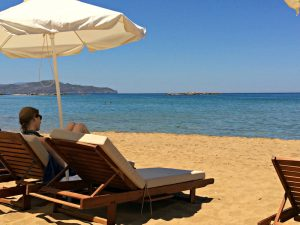 relaxing on the beach in crete greece at a 5 star hotel after yoga class