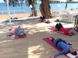 Relaxing yoga in the beautiful Crete.