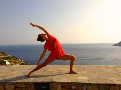 Reverse warrior in Greece on a Yoga Escape