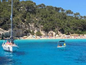 Sailing near a small beach, Menorca.