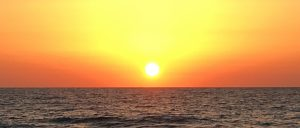 sunset in mykonos greece with yoga escapes