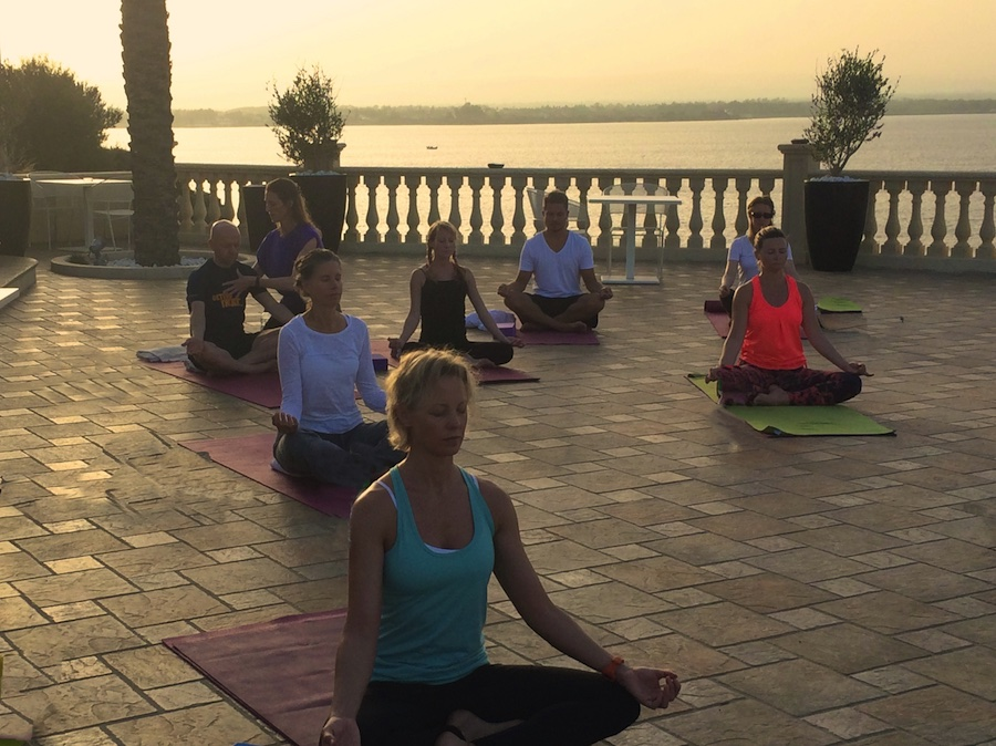 meditation at sunset on a yoga retreat in italy