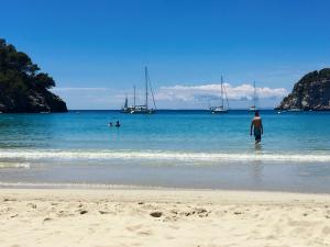 swimming on cala galdana beach menorca