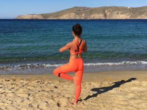tree pose on panoramas beach in mykonos greece