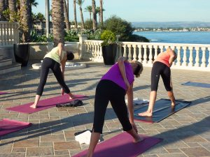 triangle poses during a yoga retreat in sicily
