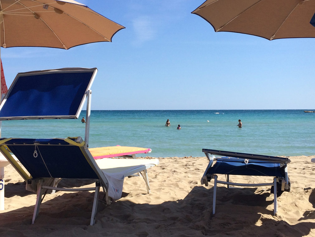 view of the beach and the sea at the Yoga Retreat in Sicily
