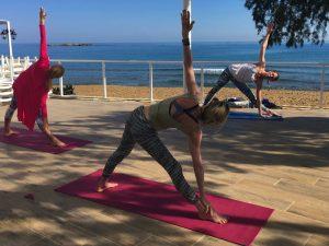vinyasa flow class on a yoga retreat in greece