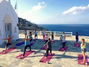 vinyasa flow class in mykonos greece on a luxury yoga retreat