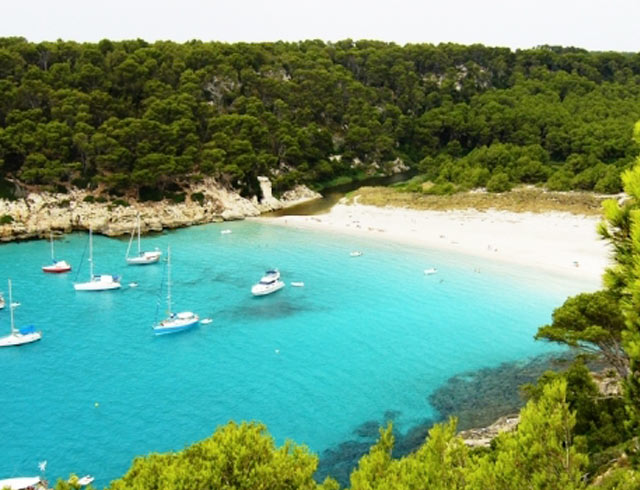 Visit cala trebaluger bay on your yoga retreat