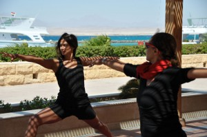 Two members of the group doing the warrior pose in Egypt.