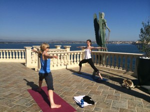 Two members of the group doing the warrior pose at the yoga retreat in Italy.